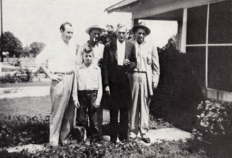 "From left to right: Jack T. Stephens, Mike Stephens, Albert Stephens, Jack ""Papa"" Stephens, and Witt Stephens in front of the family home; Prattsville, Arkansas, 1946 © Pryor Center for Arkansas Oral and Visual History, University of Arkansas"